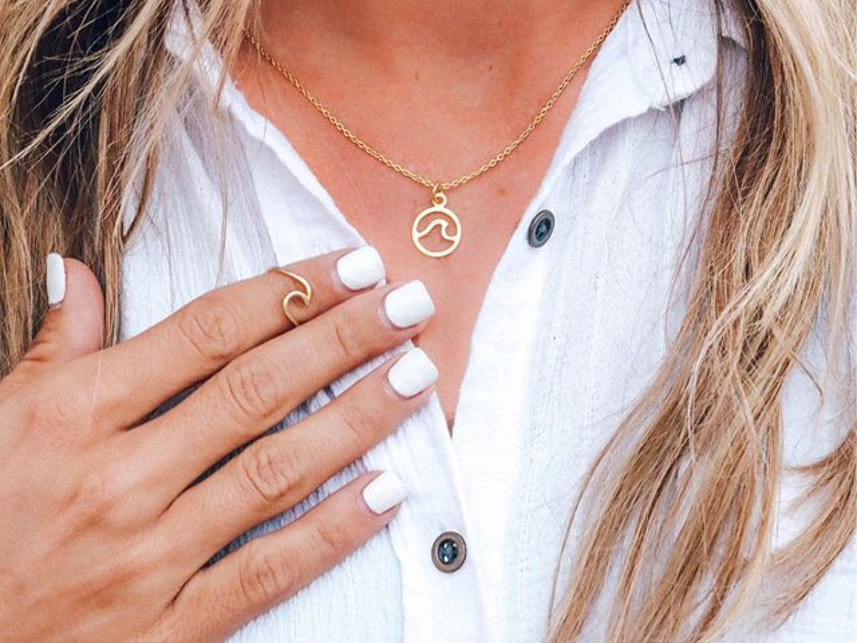 woman wearing gold wave ring