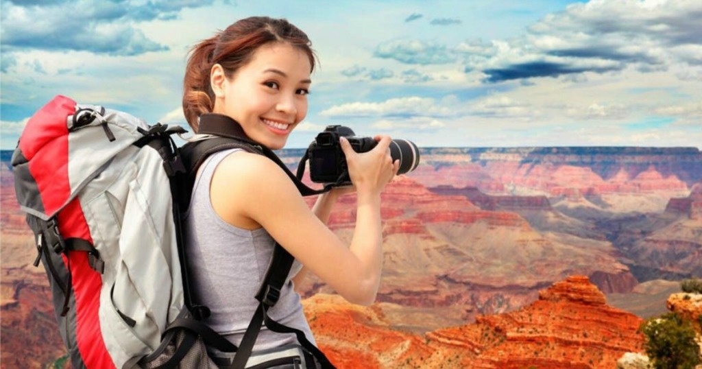 Woman taking pictures at Grand Canyon