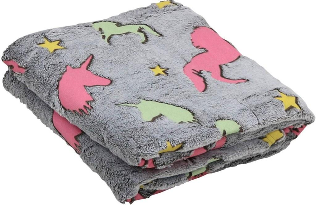 Folded unicorn throw blanket in grey