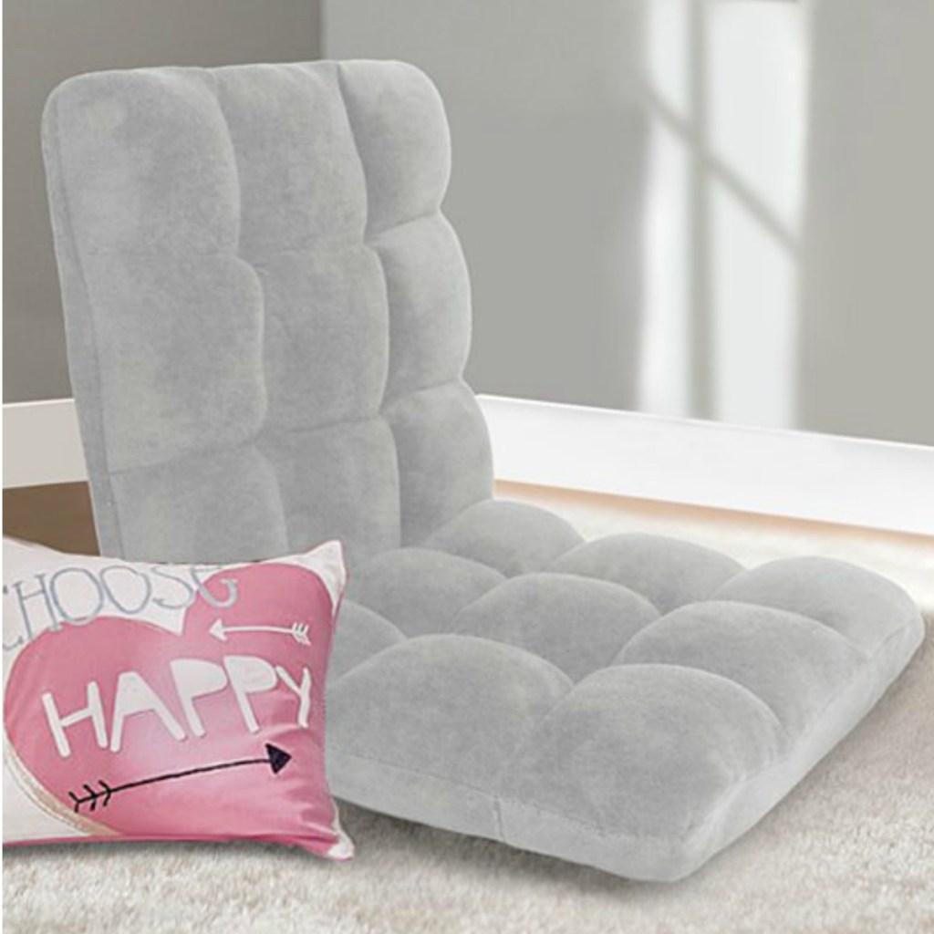 cozy grey chair on a bedroom floor