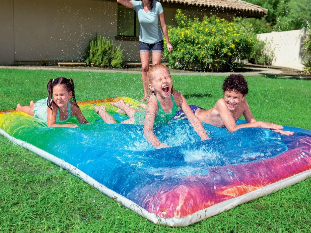 H2OGO Rainbow Blobz shown in yard with kids playing on it