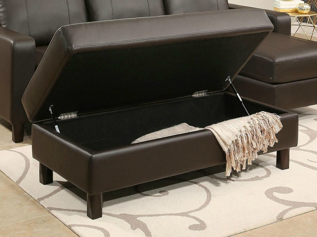 Hampton Leather Reversible Sectional and Storage Ottoman with Ottoman Opened up