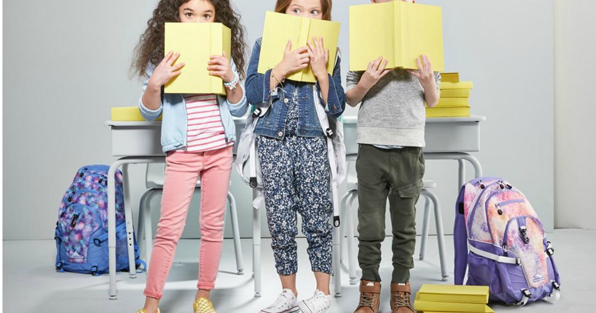 Kids at school standing next to High Sierra Backpacks