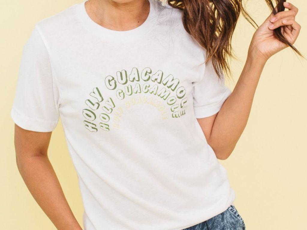 woman wearing holy guacamole tshirt