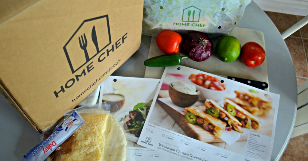 Home Chef meal box with veggies and meal plans on table