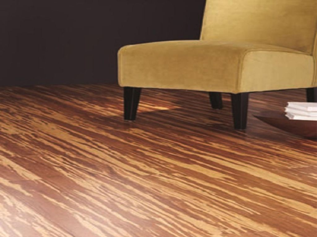 Home Decorators Collection Strand Woven Natural Tigerstripe Engineered Click Bamboo Flooring in living room with yellow chair