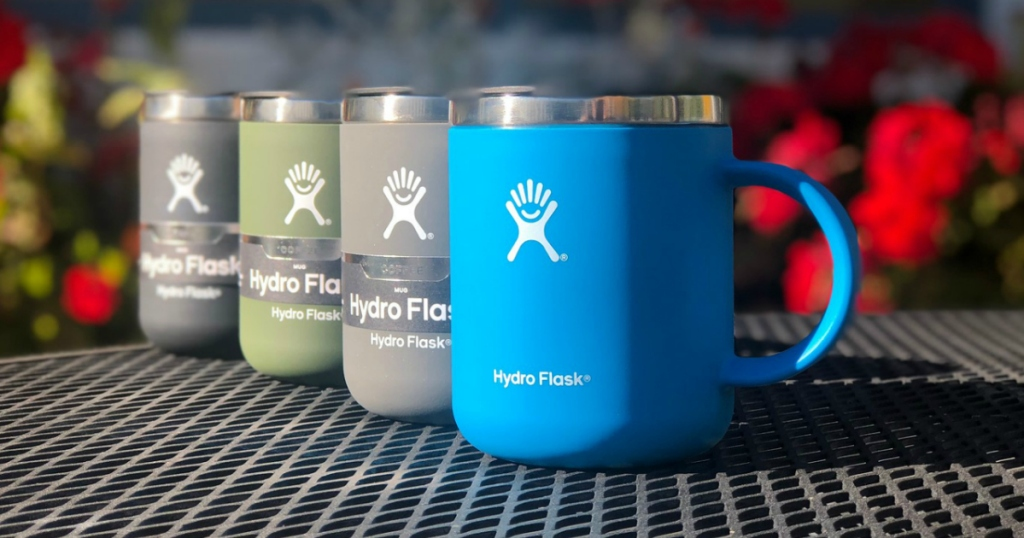 Four Hydro Flask Mugs on black grated table