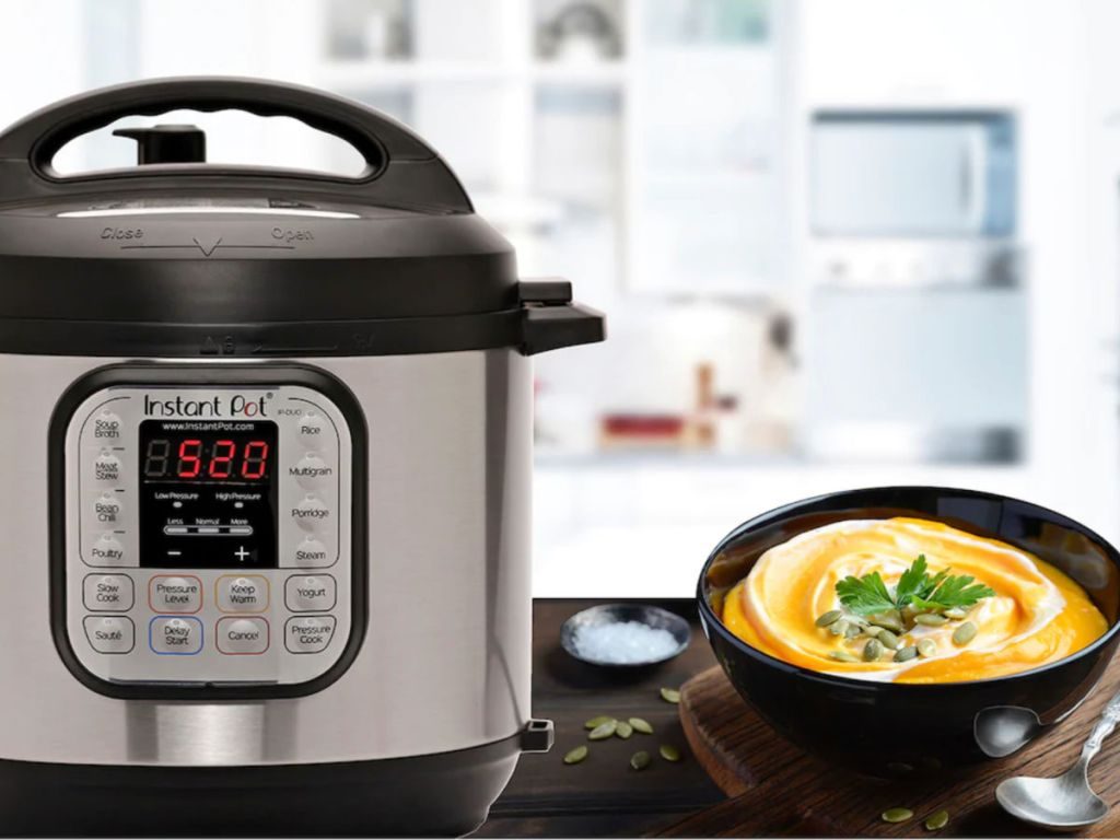 Instant Pot Duo 7-in-1 Programmable Pressure Cooker with queso cheese in a bowl