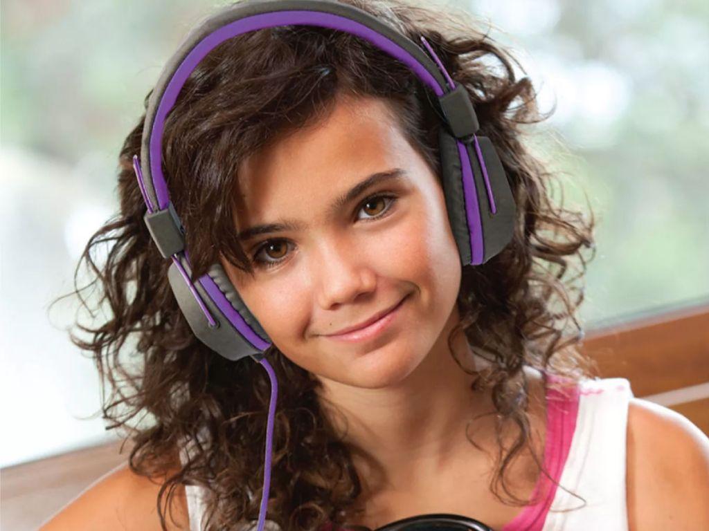 Girl wearing JLab JBuddies Studio Wired Headphone