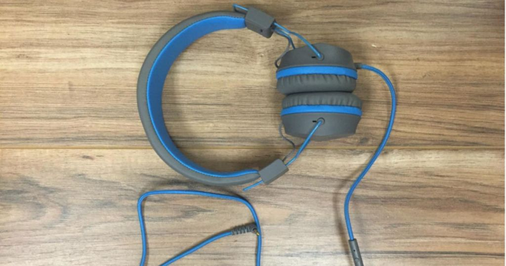JLab JBuddies Studio Wired Headphone on wooden floor