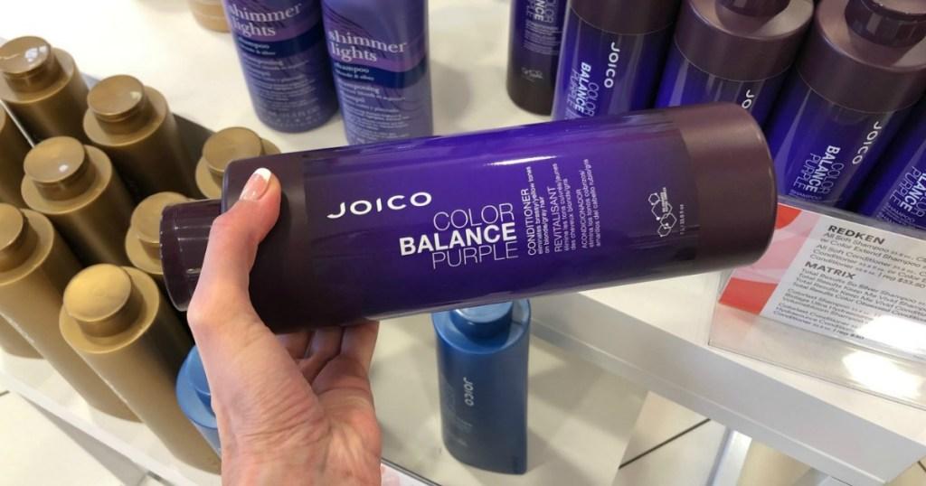 hand holding JOICO Color Balance Purple Shampoo