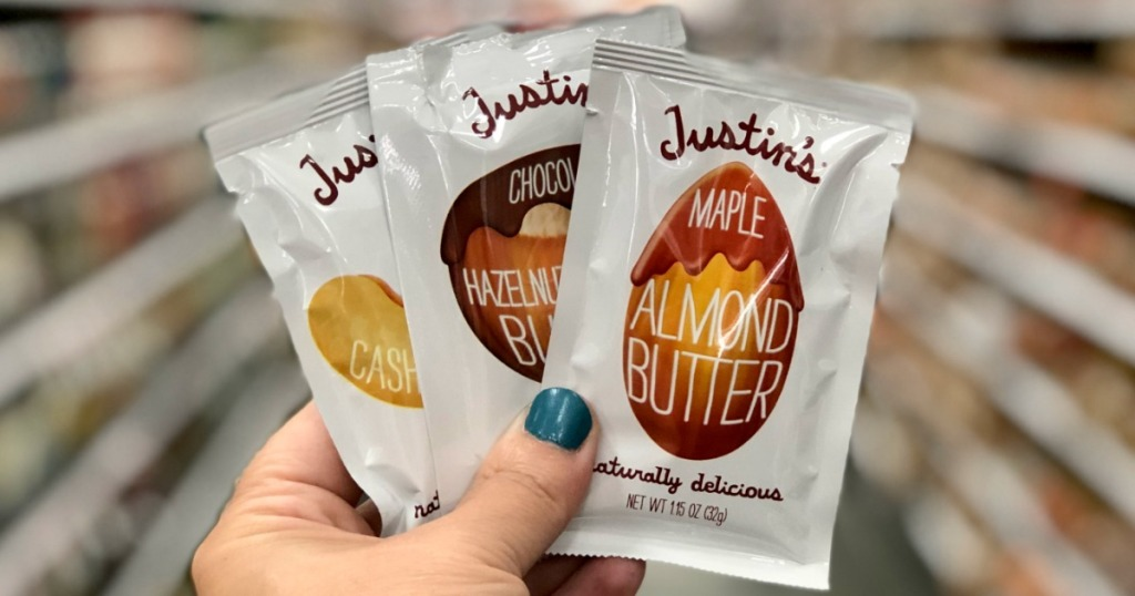 hand holding Justins Nut Butters