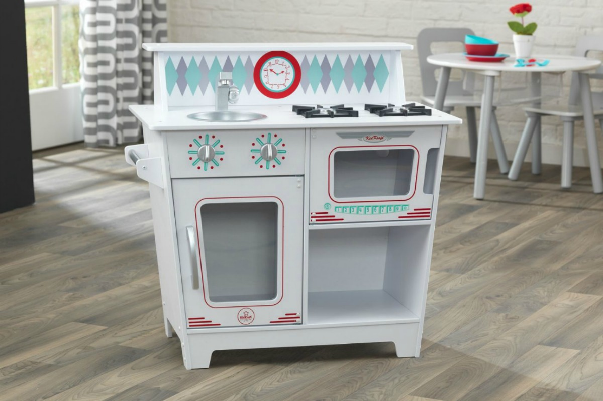 KidKraft Classic Kitchenette in front of small table and chairs set