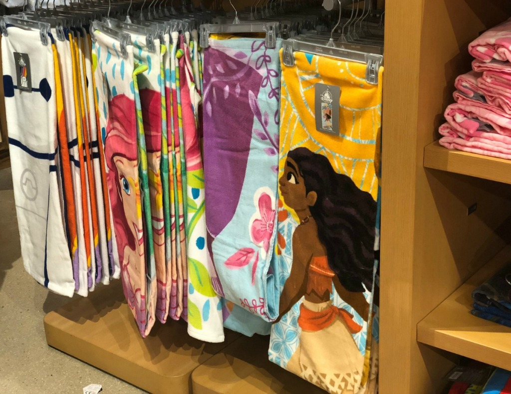 Disney store display of character beach towels