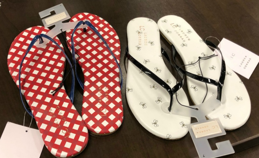 Two pairs of printed women's flip flops in store