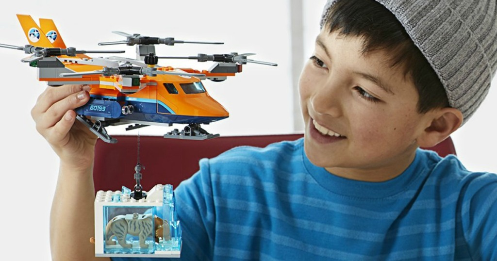 boy playing with LEGO helicopter