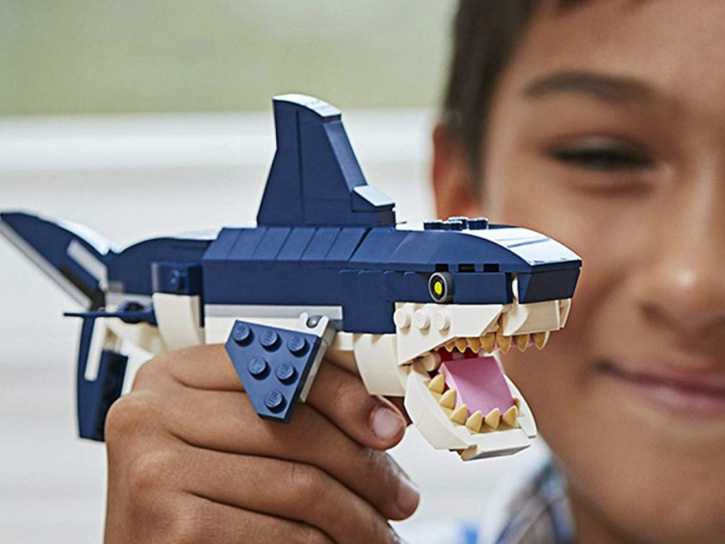 LEGO Creator 3in1 Deep Sea Creatures in child's hand close up