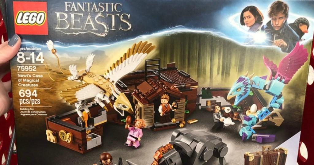 hand holding lego fantastic beasts box