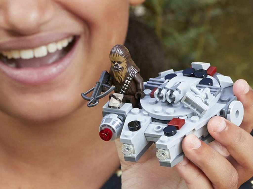 LEGO Star Wars Millennium Falcon Microfighter in child's hand close up