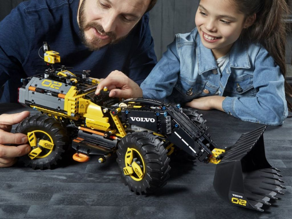man and child playing with LEGO Technic Volvo Concept Wheel Loader