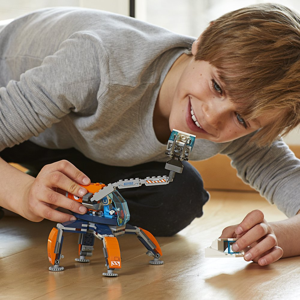 boy playing with LEGO Crawler