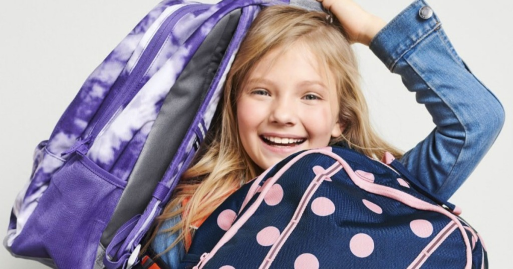 Girl holding two Lands' End large backpacks
