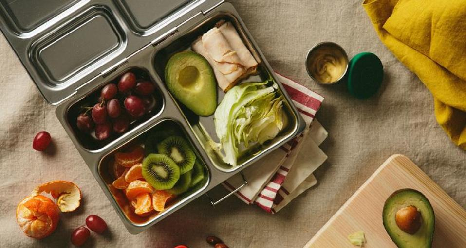 PlanetBox stainless steel Launch lunchbox filled with fruit and veggies