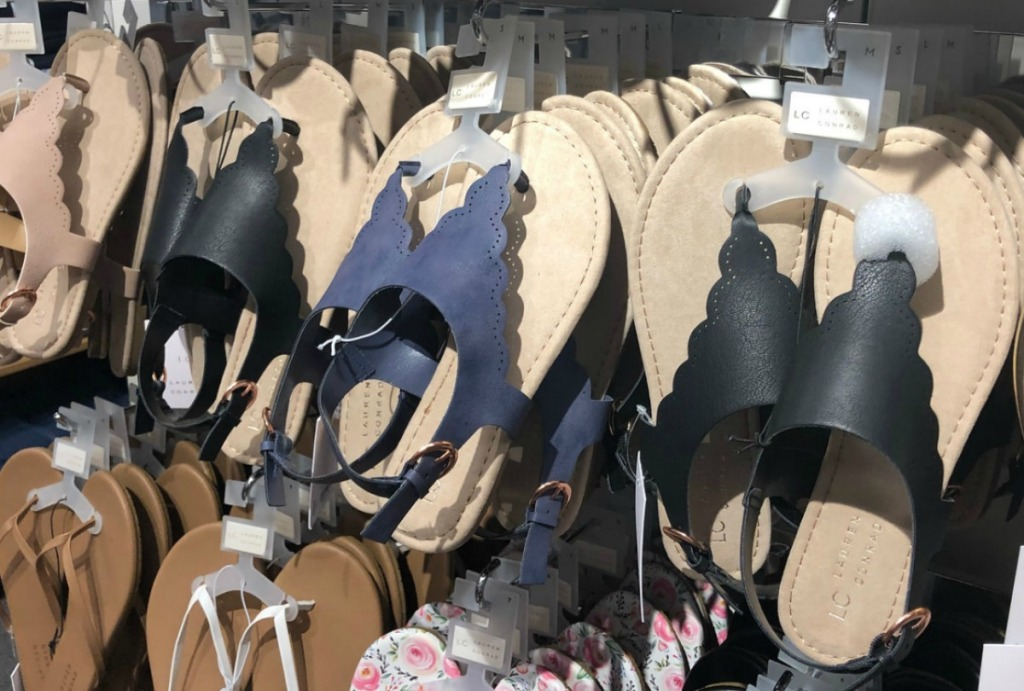 Black and blue women's sandals on display at Kohl's