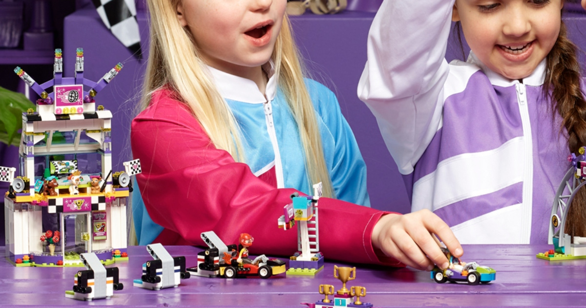 two girls playing with the Lego friends, big race day set