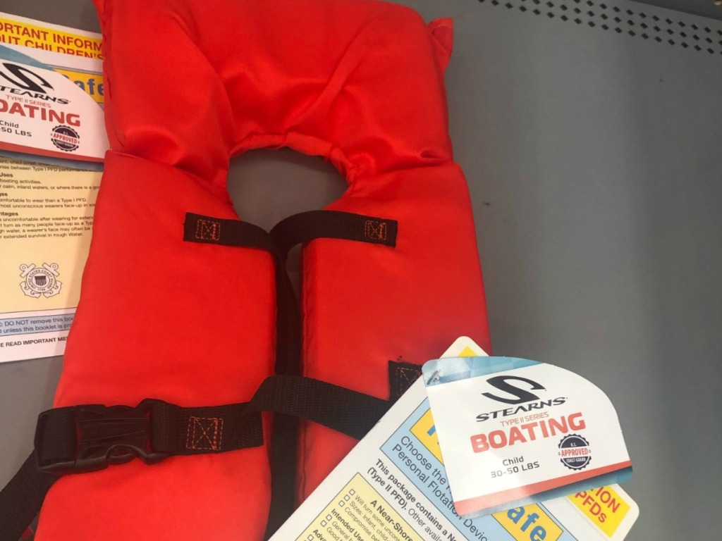 orange life jacket on the shelf at Walmart