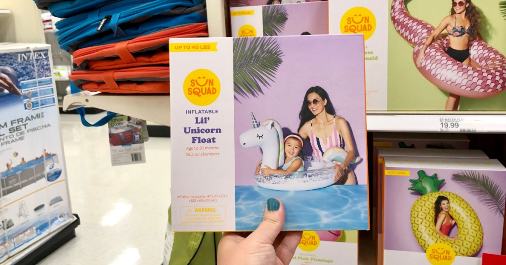 woman holding lil unicorn float at target