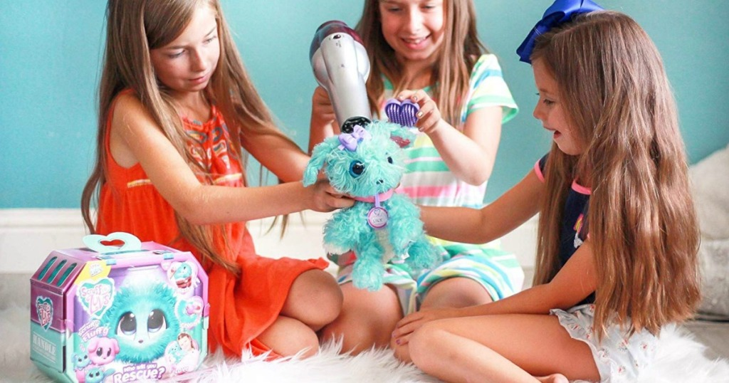 three girls blow drying a scruff a luv doll
