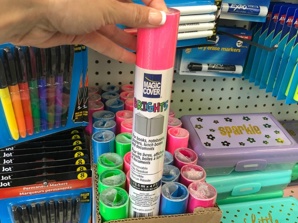 hand holding pink tube by store display