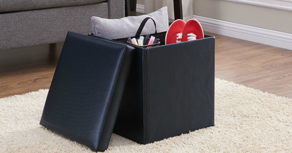 black storage ottoman filled with items