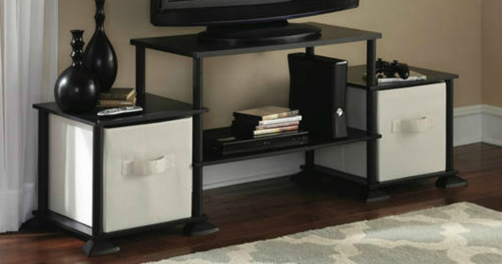 black entertainment center with bins and tv