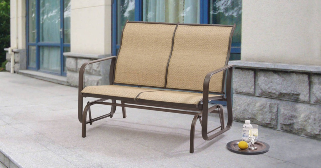 tan glider bench outdoors