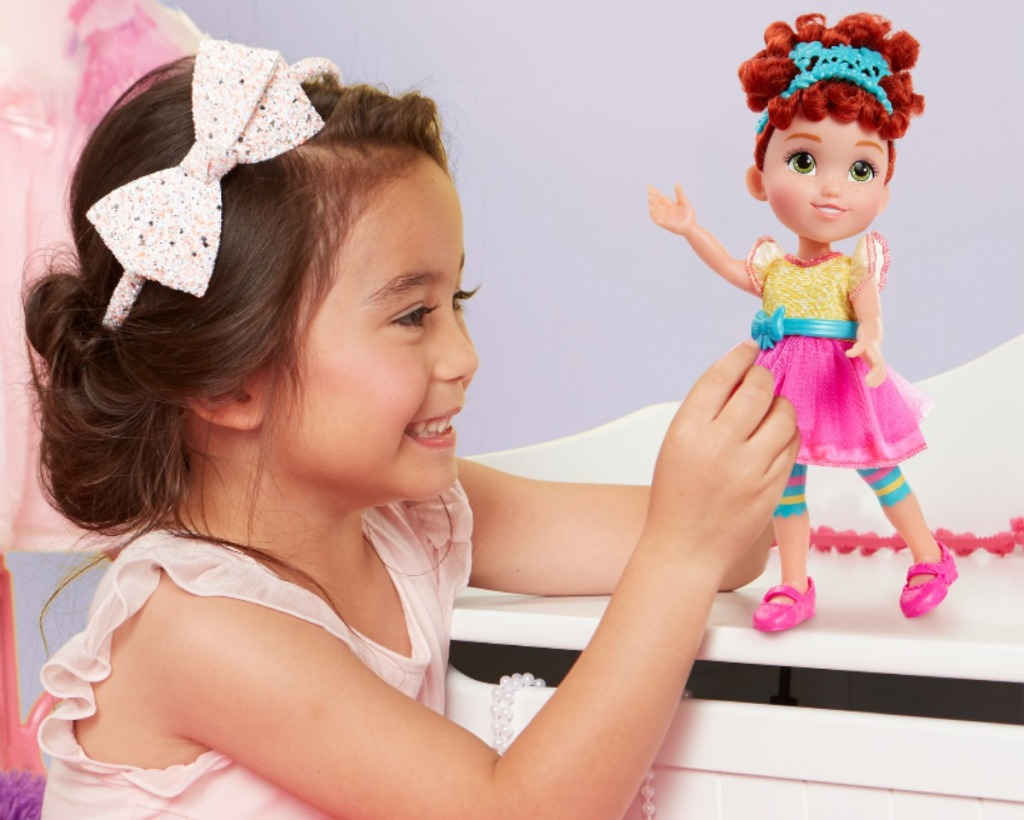 girl playing with Fancy Nancy Classique Doll