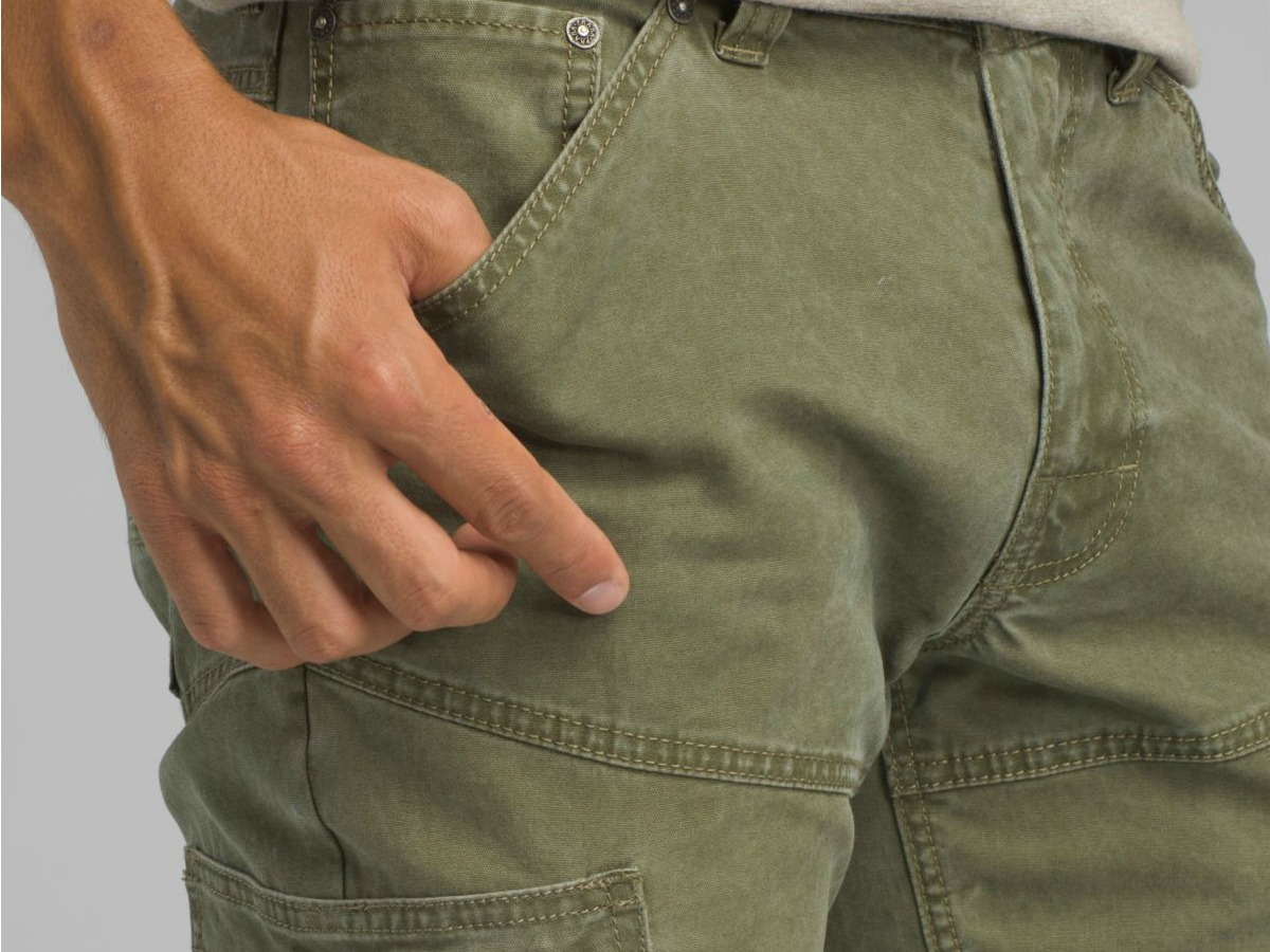 closeup of man wearing prAna pants with hands in pocket