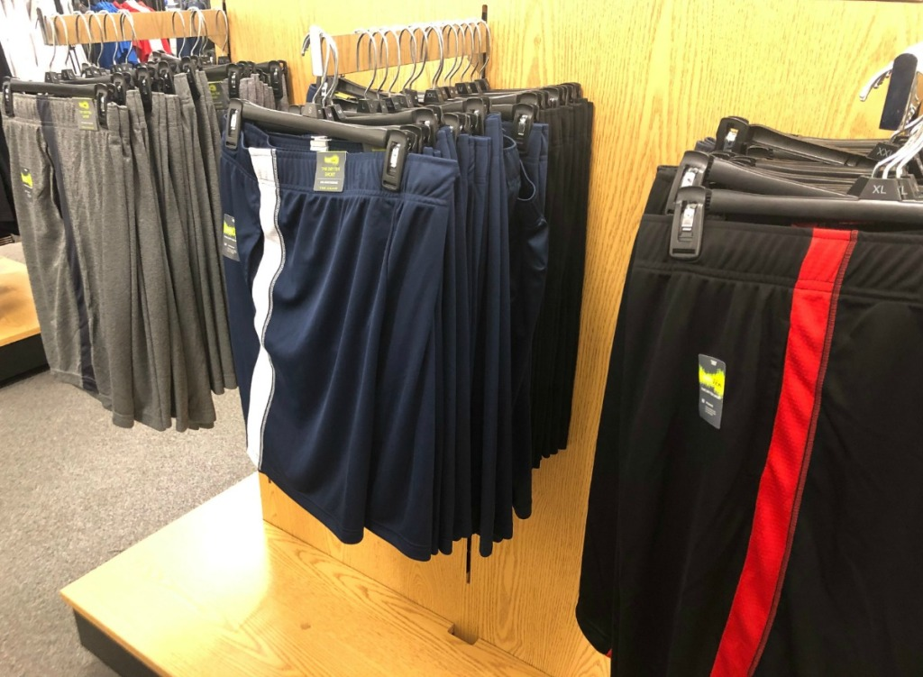 In-store display of men's active Tek Gear shorts in a variety of colors