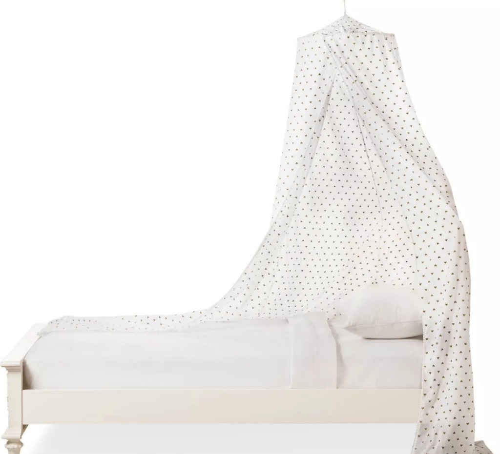 White heart print bed canopy on twin size bed