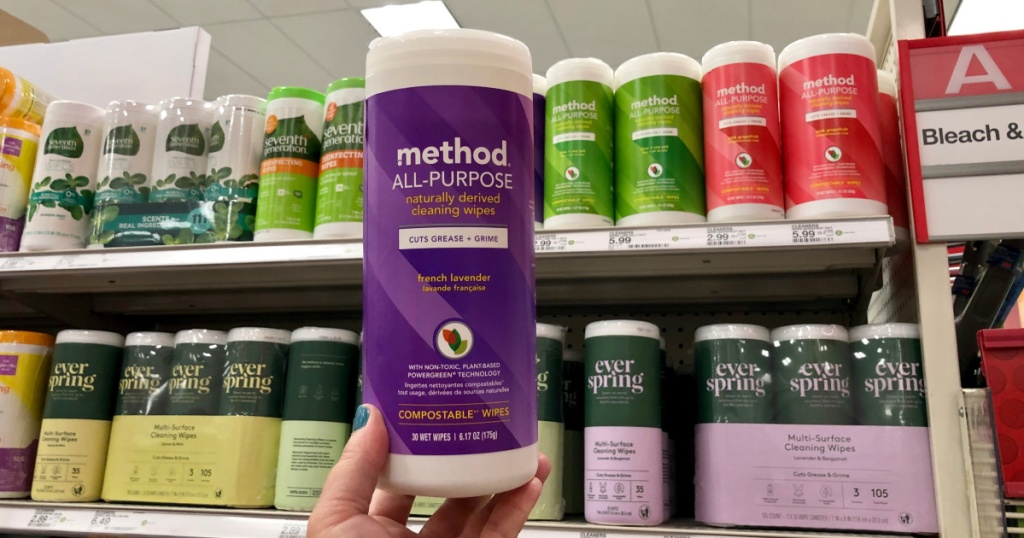 woman holding canister of lavender all purpose wipes at target