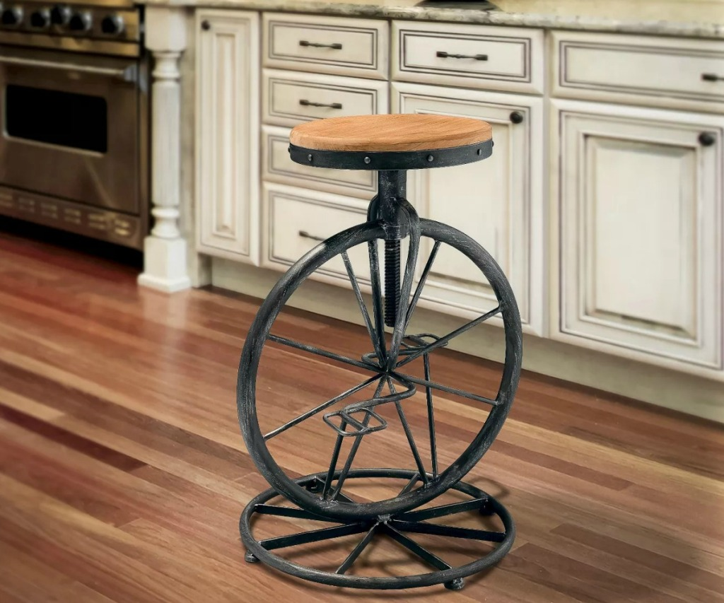 Bicycle wheel themed bar stool in kitchen