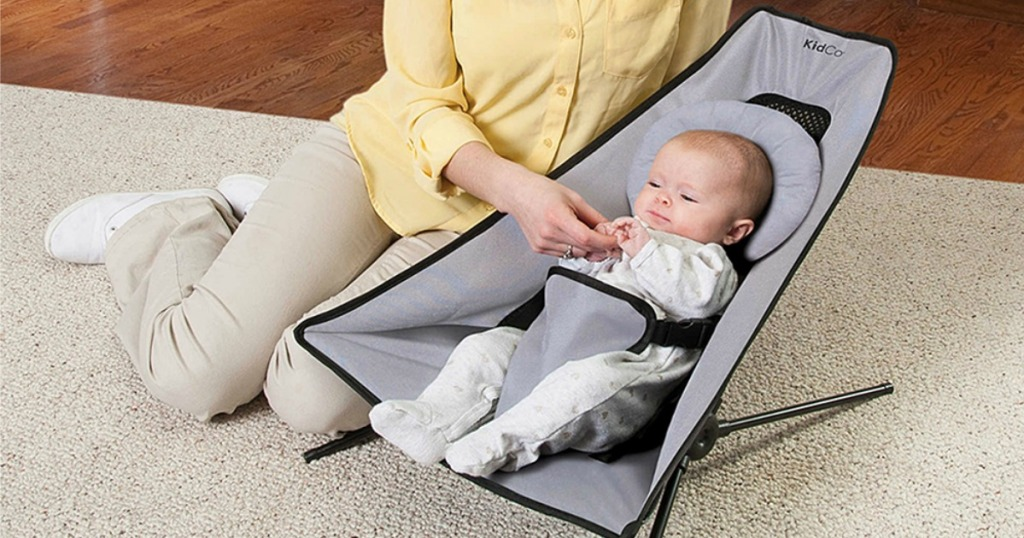 baby resting in midnight travel bouncer