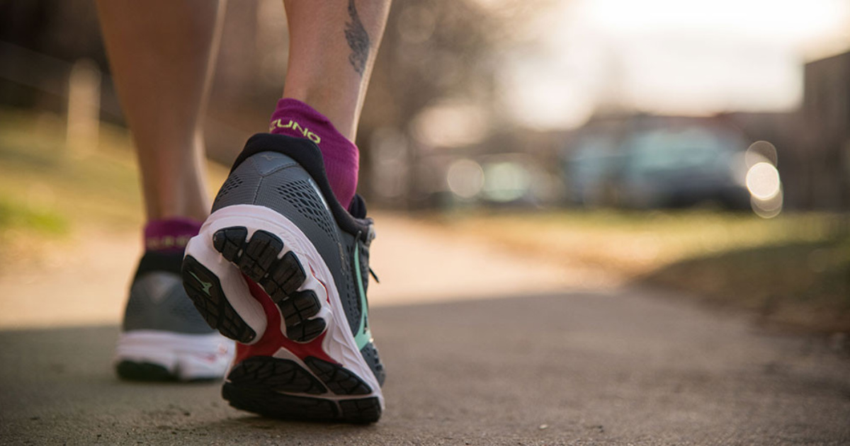 woman wearing mizuno wave rider 22 running shoes