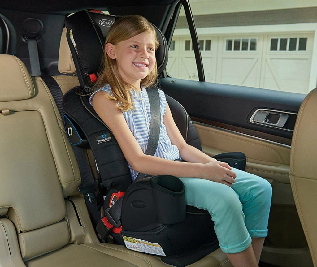 Three-in-One Harness Booster from Graco in car with child using seat-belt