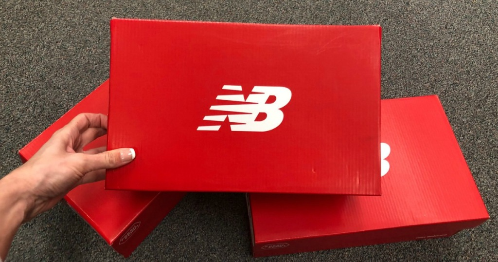 Stack of three New Balance shoe boxes
