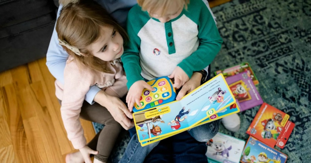 Son and daughter reading with their mom with a Paw Patrol reading set