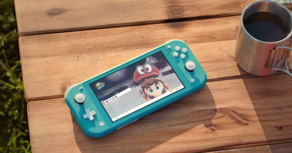 nintendo switch lite on table outside