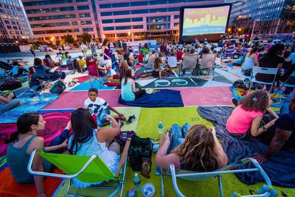 colorful outdoor space with people and outdoor movie