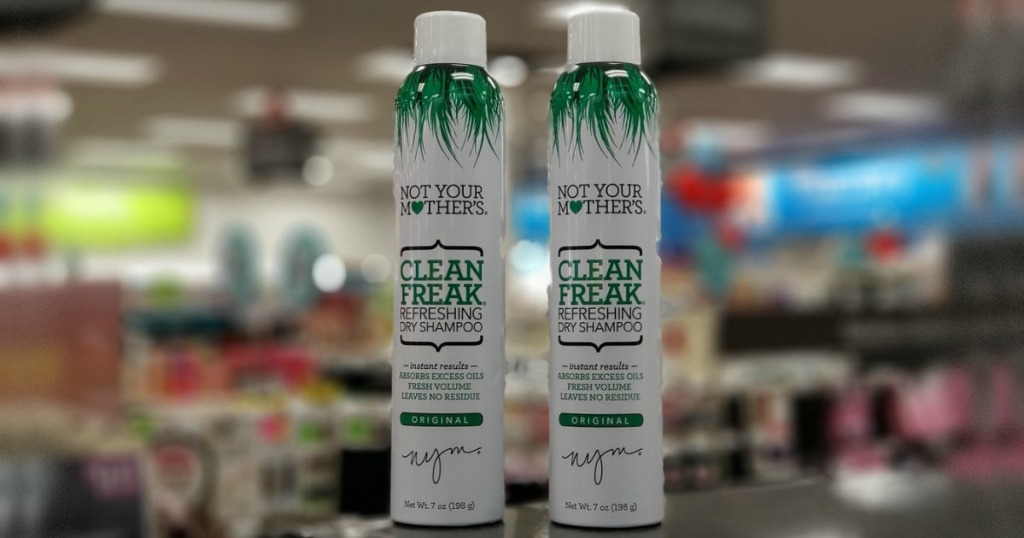 two bottles of dry shampoo in store on counter